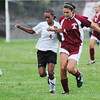Salem. Salem High School girls soccer player Ariella Crowder, left, battles with Gloucester's Nicole Reppucci for possession.    photo by Mark Teiwes / Salem News