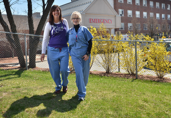Salem: Salem Hospital ER nurses Kate Crowley, left, and Patsy Emberley are running the Boston Marathon together for the MGH team in honor of an 8-year-old boy with brain cancer.   photo by Mark Teiwes / Salem News