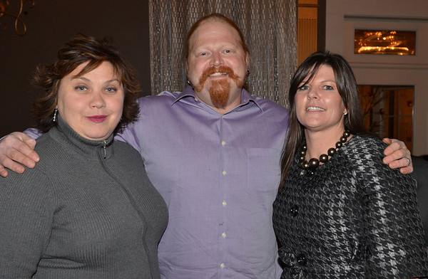 Danvers: Milissa Oraibi, left, Brenden Crocker, owners of Wildhorse Cafe, and Judy A. Field of Bernardini and Field LLP were sponsors for the event.  photo by Mark Teiwes / Salem News