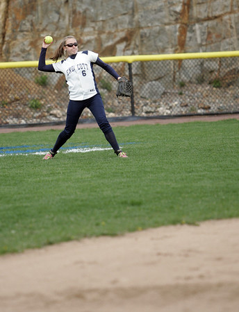 Beverly: Endicott College center fielder Ashley Wright fields a ball.  photo by Mark Teiwes / Salem News