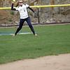 Beverly: Endicott College center fielder Ashley Wright fields a ball.  photo by Mark Teiwes / Salem News