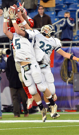 Foxborough: Pingree's Jamal Martinez, left, makes an interception on the last play of the game backed up by Jerome Cappadona in the Norm Walker Bowl at Gillette Stadium. photo by Mark Teiwes / Salem News