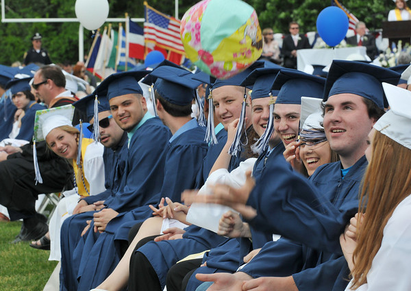Peabody: Graduates laugh as they toss a beach ball during the graduation ceremony. photo by Mark Teiwes / Salem News