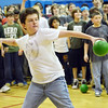 Beverly:  Briscoe Middle School 7th grader Liam Cahill winds up to knock out the last remaining teacher to win a dodge ball game.  photo by Mark Teiwes / Salem News