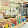 Peabody: Robert Needham of Saugus stands with his model ships at the Torigian community center. photo by Mark Teiwes / Salem News