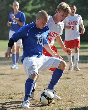Topsfield: Danvers High School boys varsity soccer player Cameron Mower, left, shields the ball from  Masconomet's Nevin Clay.  photo by Mark Teiwes / Salem News