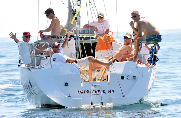 Marblehead:   The crew of the Exocet waits for the wind to pick up during Sunday's PHRF New England Championship.  photo by Mark Teiwes / Salem News