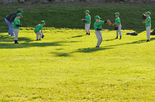 Salem: The Eagles warm up before a Salem Little League game. photo by Mark Teiwes / Salem News