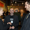 Salem:  Joe Cultrera, center, programming director of the Salem Film Fest, talks with film makers Maggie Hadleigh-West of New York City, left, and Nathan Christ of Austin Texas, right, at the opening reception.  photo by Mark Teiwes / Salem News