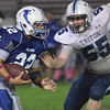 Danvers: Danvers player Nick Valles, left, makes a carries followed by Triton's Ellsworth Rogers.  photo by Mark Teiwes / Salem News