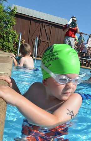 Hamilton: Evan Haughey of Hamilton, 5, gets ready to take off from the start of the TriROK Foundation's kids's triathlon fundraiser at Patton Park.    photo by Mark Teiwes / Salem News