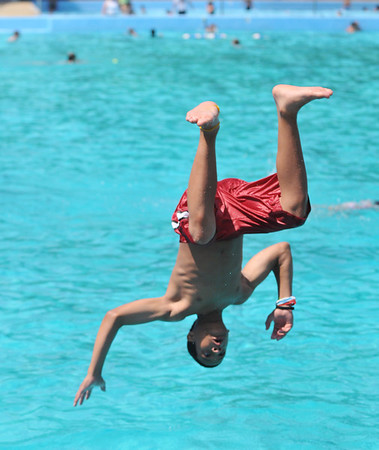 Salem: Samuel Benoit, 14 of Salem works on his dive at the Forest River Pool.  photo by Mark Teiwes / Salem News