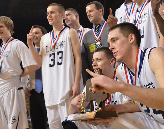 Worcester: St. John's Prep player Pat Connaughton, right, celebrates the team's championship win. photo by Mark Teiwes / Salem News