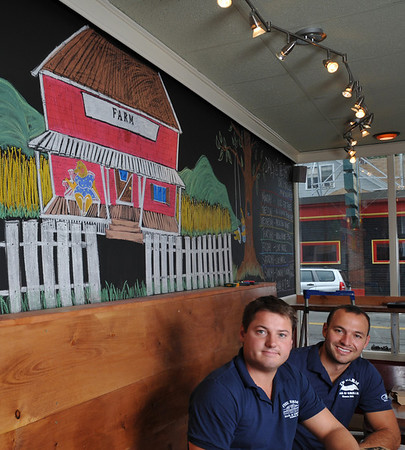 Beverly:  Cousins Ryan Cox, left, Noah Goldstein, and Brad Atkinson (not pictured) are opening the Farm Downtown in Beverly.  They are expanding after success with the Farm Barn and Grill in Essex.