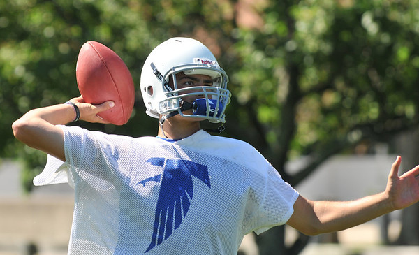 Danvers: Quarterback and captain Paul Nicolo makes a throw on the first day of practice for the Danvers High School football team.   photo by Mark Teiwes /  Salem News