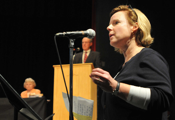 Hamilton: Hamiton resident Lynnette Fallon voices concerns about the general town appropriations for the school district during the Hamilton town meeting. photo by Mark Teiwes / Salem News