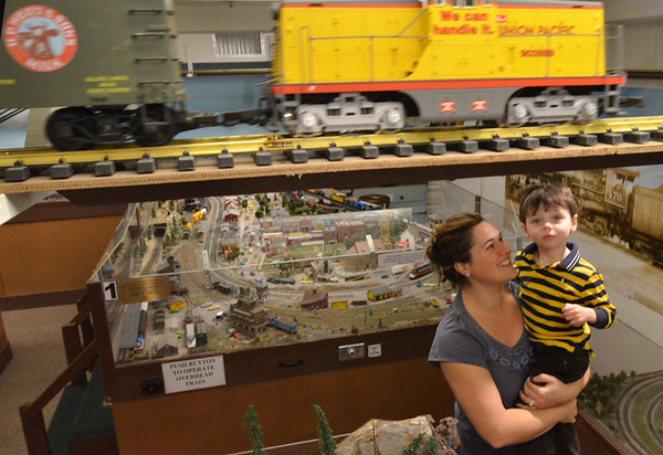 Wenham:  Arrianna Harvey and her son Austin, 3, of Beverly check out the train exhibit at the Wenham Museum. photo by Mark Teiwes  / Salem News