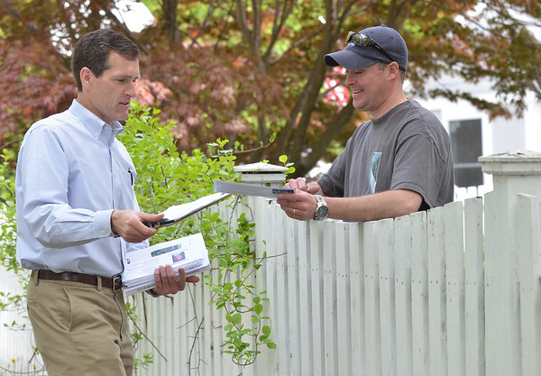 Beverly: Mayoral candidate Mike Cahill, left, campaigns along Foster Street speaking with Sean Corcoran.  photo by Mark Teiwes / Salem News