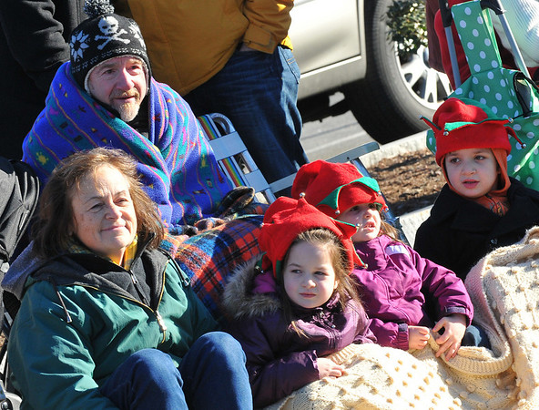 Beverly: Jan and Bob Dorey, left, bundled up to watch the parade with their grandchildren Savannah, 4, Abigail, 3, and Benjamin Dorey, 6, all from Beverly.  photo by Mark Teiwes / Salem News