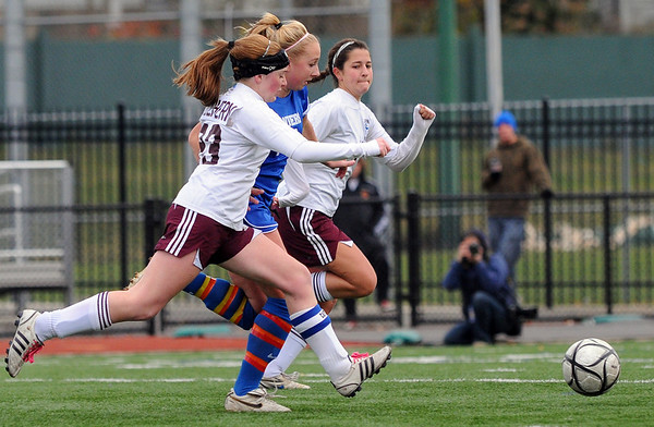 Lynn: Danvers Corey Persson, center, gets double-teamed by Belmont defenders on her way to the goal in Division 2 North finals. photo by Mark Teiwes / Salem News