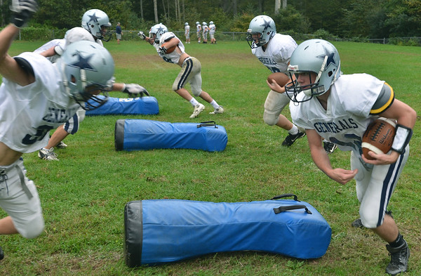 Hamilton: Hamilton-Wenham's Steven Turpin, left, and Trevor Lyons run through a drill at the start of practice.  photo by Mark Teiwes / Salem News