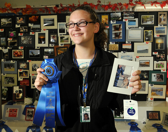"Topsfield:  Beth Arnold won a first prize ribbon for her photo in the ""man's best friend"" category."
