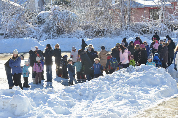 Marblehead: Parents meet their children ending the day at Bell School.  photo by Mark Teiwes  / Salem News