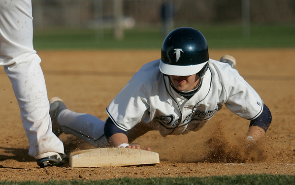 Danvers: Danvers captain Nick Gikas dives back into first after leading off.  photo by Mark Teiwes / Salem News