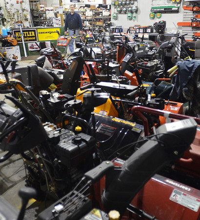 Peabody: Paul Hincman, owner of Outdoor Power Equipment in Peabody stands before a shop full of snowblowers waiting to be repaired. photo by Mark Teiwes / Salem News