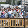 "Beverly: People gather listening to the music by the band ""Music Street"" for an event sponsored by the Beverly Harbor Management Authority at Glover Wharf. photo by Mark Teiwes / Salem News"