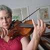 Essex:  Maria Bennotti, founder of Music from Eden's Edge chamber music group, practices at her home.  The group will celebrate its 30th anniversary.   photo by Mark Teiwes  / Salem News