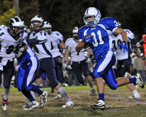 Danvers: Danvers' Jim Oliveri gains yards on a run. photo by Mark Teiwes / Salem News