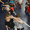 Danvers:  7-year -old Ethan Doyle of Salem, left practices a wrestling move with Josh Applestein, 7, of Middleton, at the North Shore Youth Wrestling clinic.    photo by Mark Teiwes / Salem News