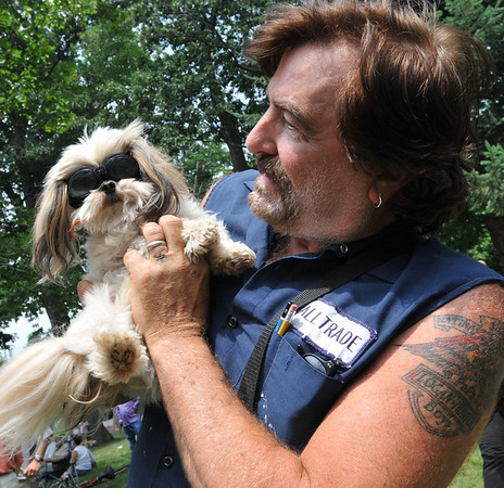 Danvers: Lee Blais of Danvers holds Sprocket, his Toy Mutt at a dog show raising money for Strays in Need.  Lee and Sprocket love to ride a motorcycle.  photo by Mark Teiwes / Salem News