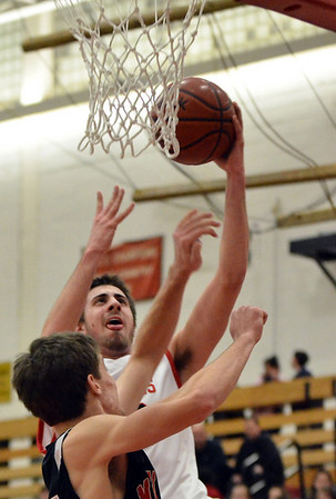 Salem: Salem High School forward Jake Salamida makes a layup over Marblehead's Phil Coughlin. photo by Mark Teiwes / Salem News