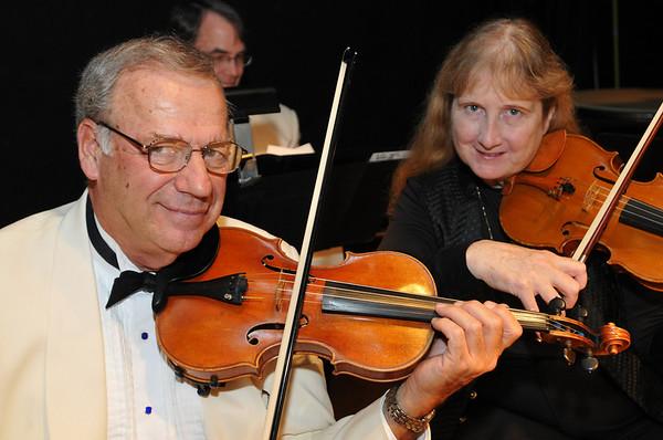 Hamilton: Violinists Alan Hawryluk of Salem, left, and Jane Hemenway of Somerville performed with the Hillyer Festival Orchestra.  photo by Mark Teiwes / Salem News