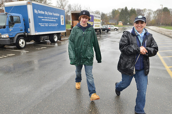 Hamilton: Josephine Currie of Hamiton Wenham Green and her son Nick, help collect donations for Big Brother Big sister and Got Books at the high school.  The Earth Day event was sponsored by Danvers Bank.   photo by Mark Teiwes