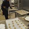 Middleton: A.J. DeMontier of Swampscott churns out a steady stream of cookies for the North Shore Technical High School open house.   photo by Mark Teiwes / Salem News
