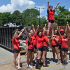 Salem: Salem High School football cheerleaders strike a pose at their scrap metal fundraiser to purchase equipment and help with cost of the upcoming football cheering season.  They will have another metal drop off date in August.  photo by Mark Teiwes / Salem News