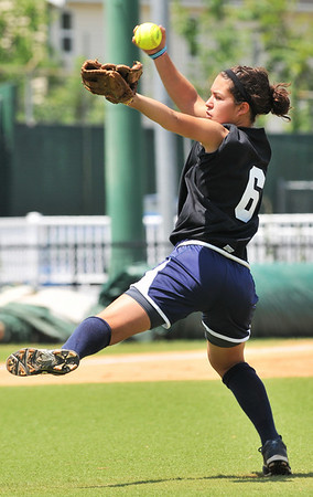 Lynn: South team starting pitcher Cortney Fletcher, of Swampscott winds up for a pitch at the 13th annual Agganis All-Star Classic softball game. photo by Mark Teiwes / Salem News