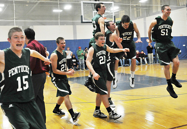 Hamilton:   Pentucket boys basketball celebrates their Division 3 North first round state tournament win over Hamilton-Wenham.  photo by Mark Teiwes / Salem News