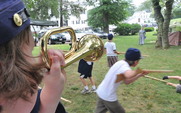 "Wenham:  Jacob Bettencourt of Peabody, 11, sounds the alarm during ""A Civil War Soldier's Life,"" a summer youth program at the Wenham Museum.  Children ""enlist"" and spend the week experiencing what life would be like for a civil war soldier.  photo by Mark Teiwes / Salem News."