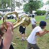 """Wenham:  Jacob Bettencourt of Peabody, 11, sounds the alarm during """"A Civil War Soldier's Life,"""" a summer youth program at the Wenham Museum.  Children """"enlist"""" and spend the week experiencing what life would be like for a civil war soldier.  photo by Mark Teiwes / Salem News."""