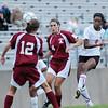 Salem. Salem High School girls soccer captain Jasmine Bryant shoots through the Gloucester defense for her second goal in the first half.   photo by Mark Teiwes / Salem News