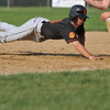 Beverly: Beverly's Anthony DiOrio dives safe into first after leading off. photo by Mark Teiwes / Salem News