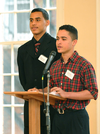 "Salem:  Salem Cyber Space honors its class of graduating seniors. Josh Santana, right, speaks about his experience moving the US and learning English with the help of the center.  Manny Cruz, left, emceed the night and performed a rap he wrote entitled, ""New Life."" Photo by Mark Teiwes / Salem News"