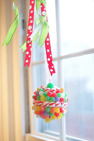 Marblehead: Balls of candy hang in the windows of the Marblehead Arts Association .   photo by Mark Teiwes / Salem News