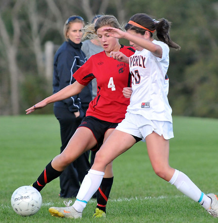 Beverly:  Salem's Julia Jackson, left, makes a pass challenged by Beverly's Kristen O'Connor.  photo by Mark Teiwes  / Salem News