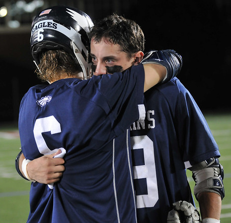 Boston: St. John's Prep player Conor Kelley, left, hugs Mark MacDonald after their loss in the State final to Duxbury at Harvard Stadium. photo by Mark Teiwes