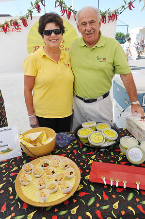 Marblehead: Pam and Joe Granese of Marblehead sell salsa and salstina they made.  The couple appreciates the strong sense of community at the farmers market.   photo by Mark Teiwes / Salem News